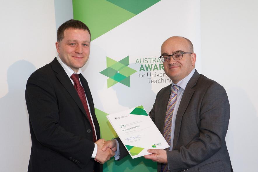 Stephen Woodcock receiving his award