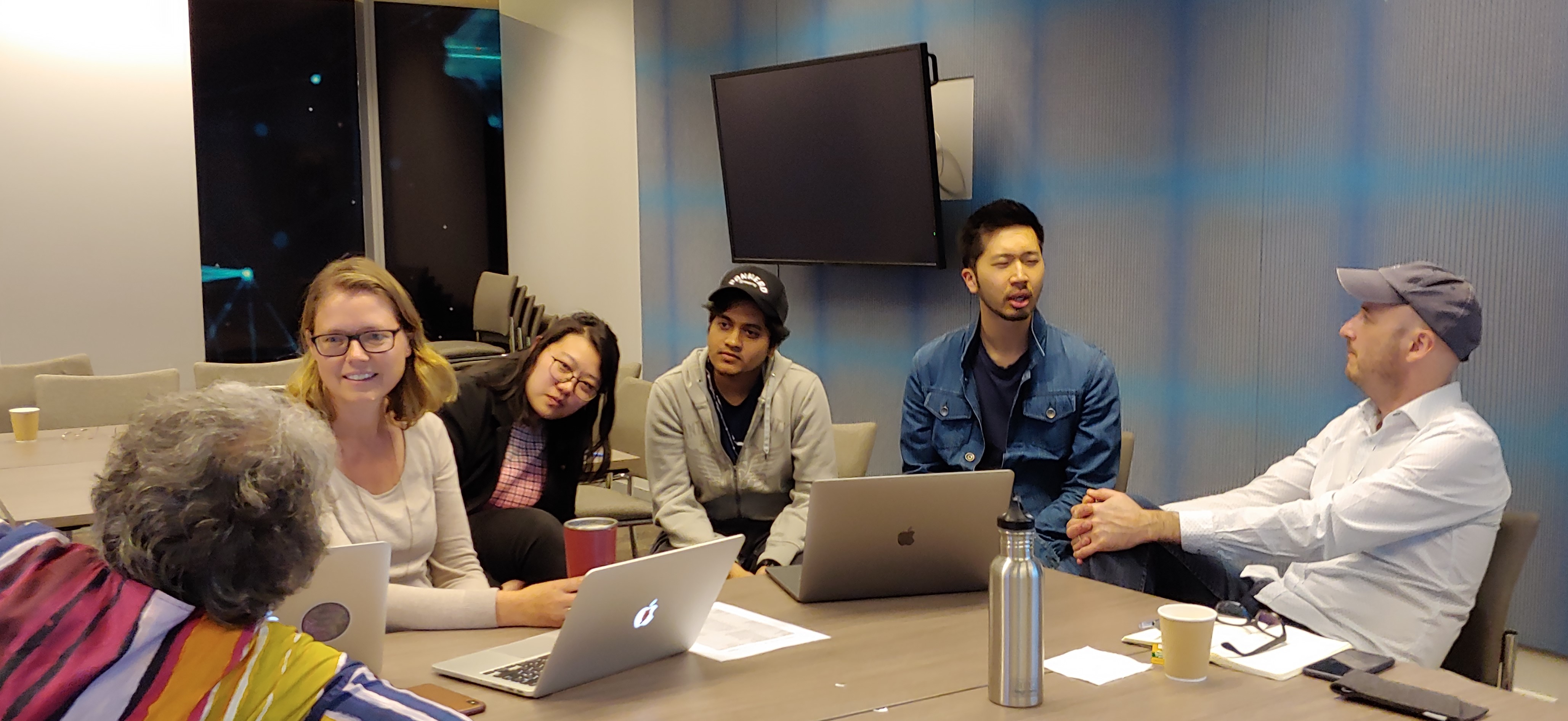 A picture of students and academics discussing the design of the Interaction Media course.