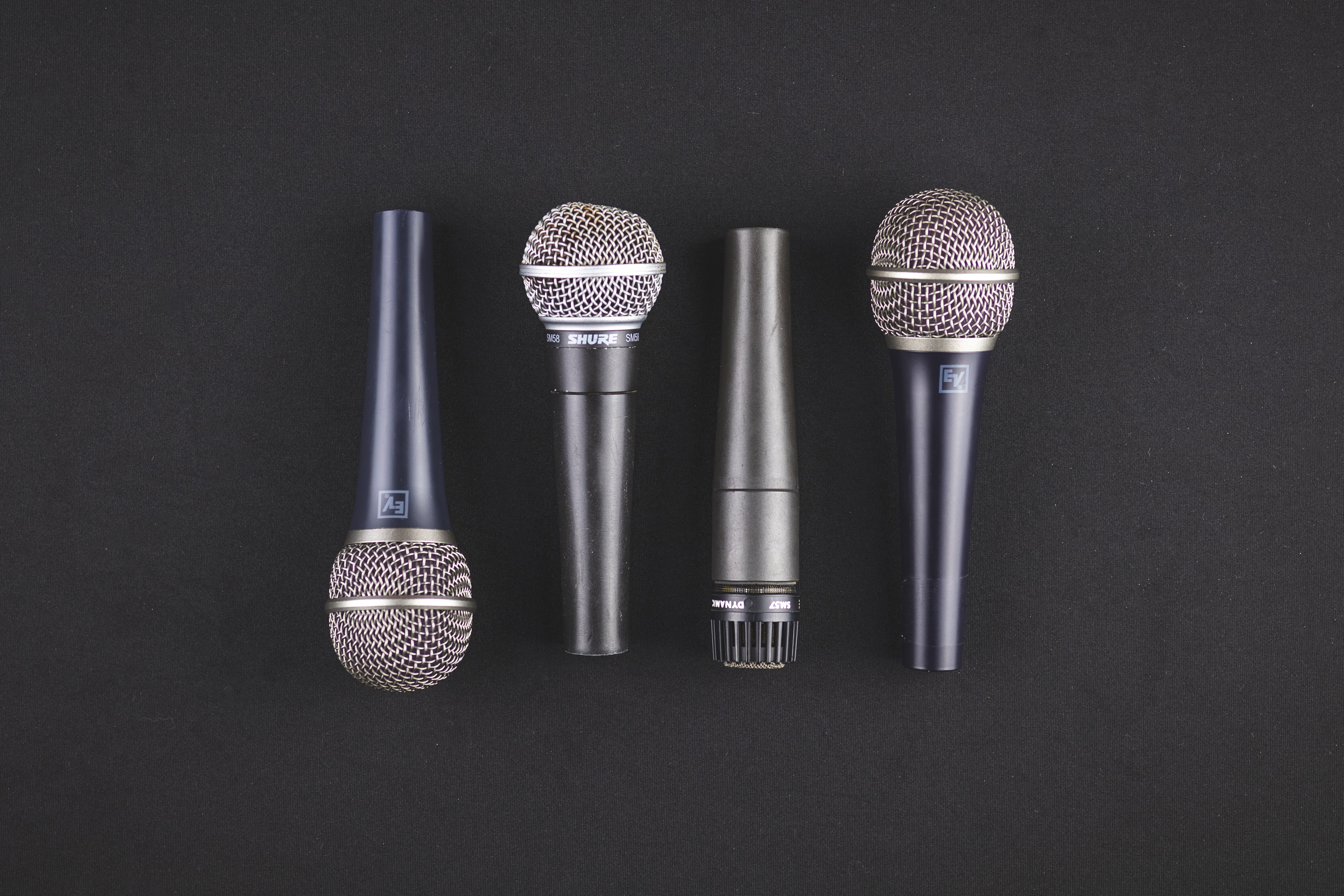A row of hand held microphones
